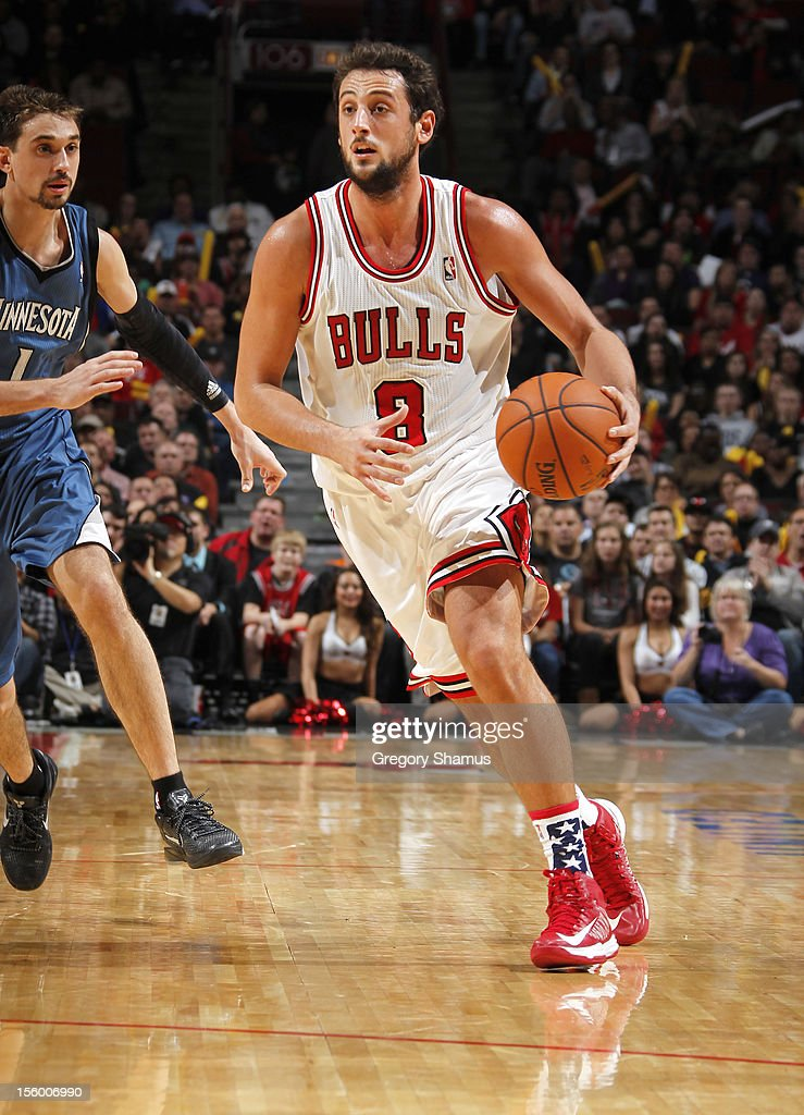 Marco Belinelli #8 of the Chicago Bulls moves the ball past Alexey Shved #1 of the Minnesota Timberwolves on November 10, 2012 at the United Center in Chicago, Illinois.