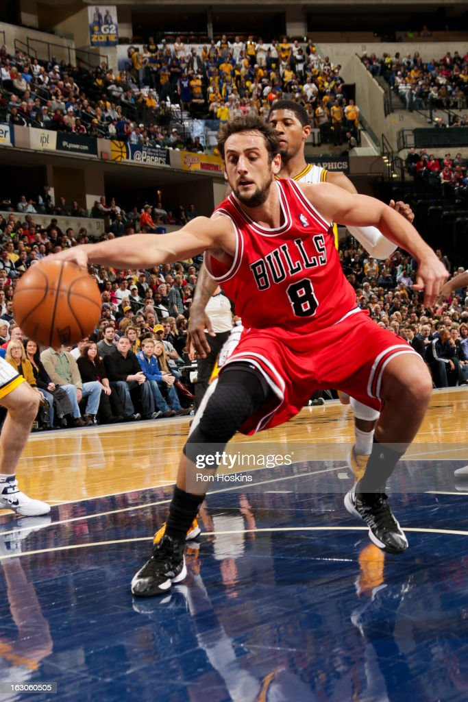 Marco Belinelli #8 of the Chicago Bulls reaches for a loose ball against the Indiana Pacers on March 3, 2013 at Bankers Life Fieldhouse in Indianapolis, Indiana.