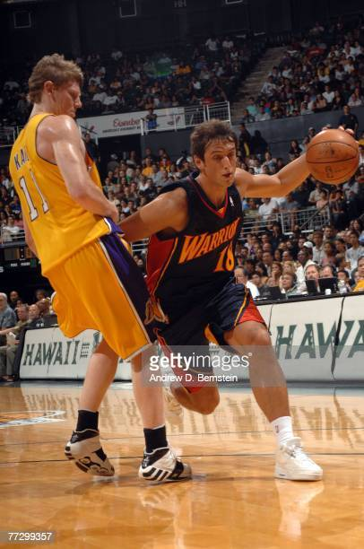 Marco Belinelli of the Golden State Warriors drives past Coby Karl of the Los Angeles Lakers at the Stan Sheriff Center on October 11, 2007 in...