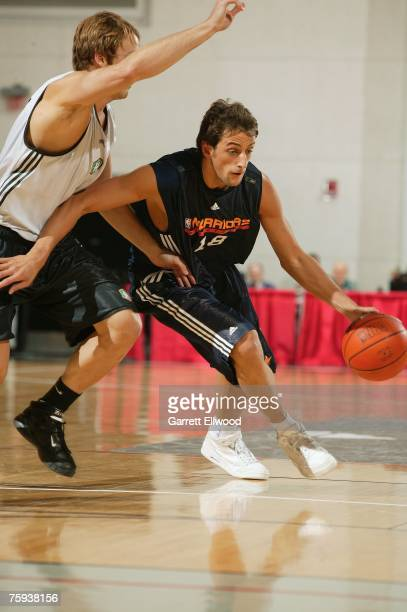 Marco Belinelli of the Golden State Warriors drives upcourt during Game 1 of the NBA Summer League against the New Orleans Hornets on July 7, 2007 at...