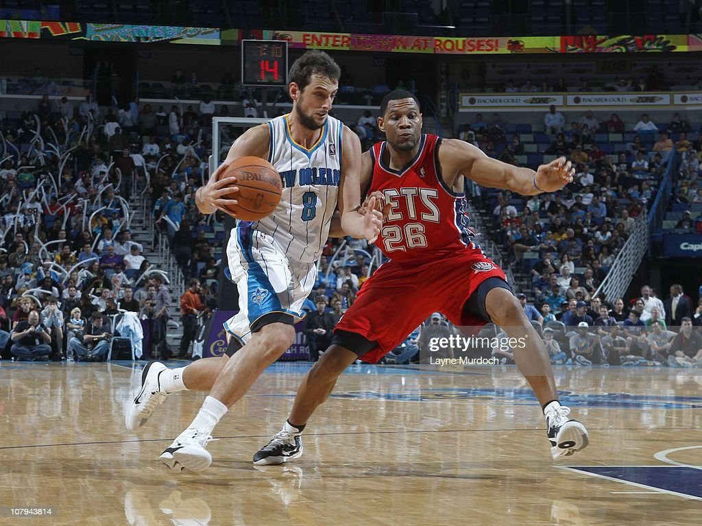 bbfaf84fb Marco Belinelli of the New Orleans Hornets drives to the basket ...