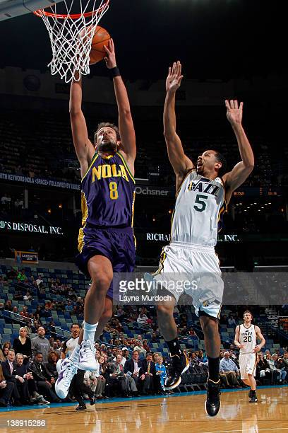 fd4aeb20d Marco Belinelli of the New Orleans Hornets dunks against Devin Harris of  the Utah Jazz on