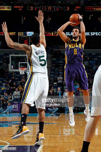 f3e2f577a Marco Belinelli of the New Orleans Hornets shoots against Devin Harris of  the Utah Jazz on