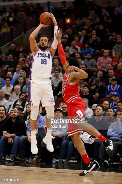Marco Belinelli of the Philadelphia 76ers attempts a shot while being guarded by Cameron Payne of the Chicago Bulls in the first quarter at the...