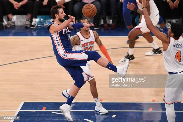Marco Belinelli of the Philadelphia 76ers passes the ball against Isaiah Hicks of the New York Knicks during the game at Madison Square Garden on...
