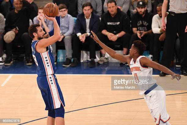 Marco Belinelli of the Philadelphia 76ers shoots the ball against Frank Ntilikina of the New York Knicks during the game at Madison Square Garden on...