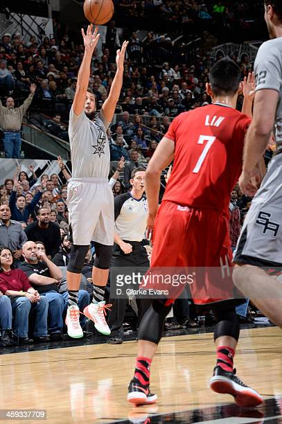 Marco Belinelli of the San Antonio Spurs attempts a shot during a game against the Houston Rockets on December 25 2013 at the ATT Center in San...