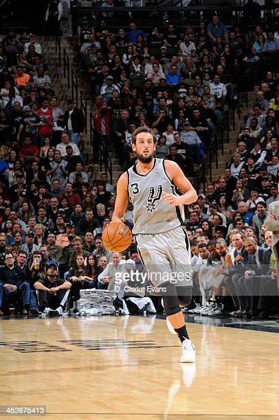 Marco Belinelli of the San Antonio Spurs controls the ball against the Houston Rockets at the ATT Center on November 30 2013 in San Antonio Texas...
