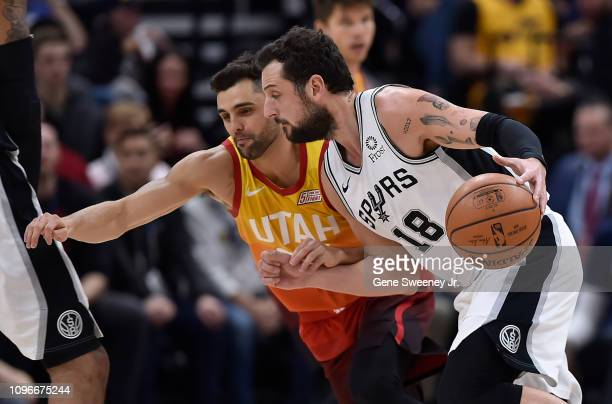 Marco Belinelli of the San Antonio Spurs drives around Raul Neto of the Utah Jazz in the first half of a NBA game at Vivint Smart Home Arena on...