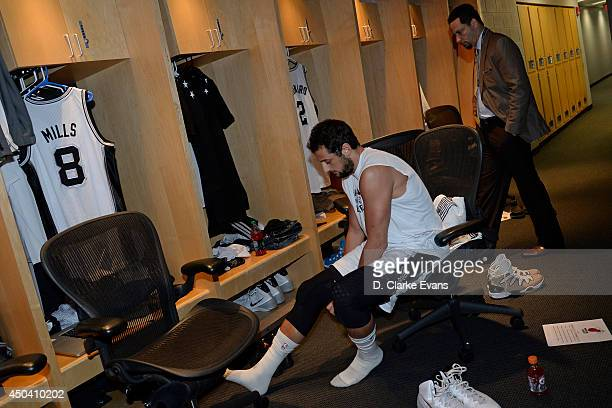 Marco Belinelli of the San Antonio Spurs gets ready in Spurs locker room before Game Two of the 2014 NBA Finals on June 8 2014 at the ATT Center in...