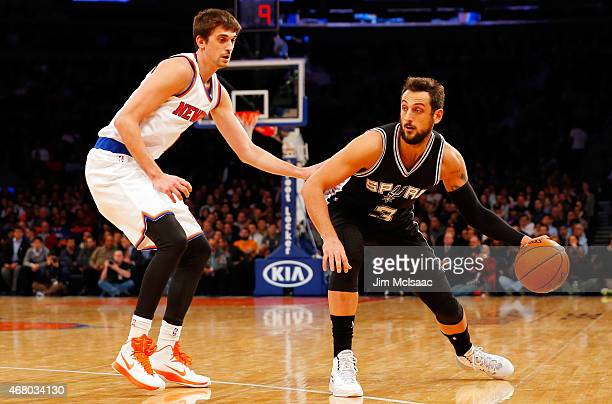 Marco Belinelli of the San Antonio Spurs in action against Alexey Shved of the New York Knicks at Madison Square Garden on March 17 2015 in New York...