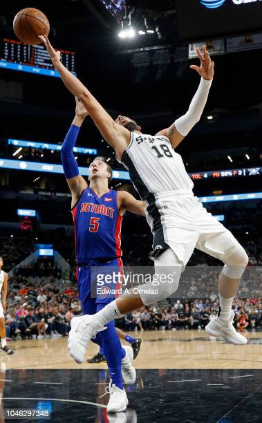 Marco Belinelli of the San Antonio Spurs loses control of the ball after being fouled by Luke Kennard of the Detroit Pistons during a preseason game...