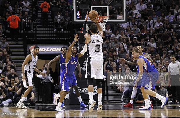 Marco Belinelli of the San Antonio Spurs shoots a three point shot over Chris Paul of the Los Angeles Clippers during Game Six of the Western...