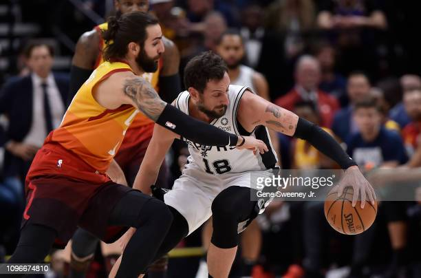 Marco Belinelli of the San Antonio Spurs steers the ball away from Ricky Rubio of the Utah Jazz in the first half of a NBA game at Vivint Smart Home...