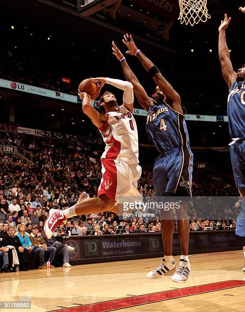 Marco Belinelli of the Toronto Raptors glides to the basket guarded by Antawn Jamison of the Washington Wizards during a game on October 11 2009 at...