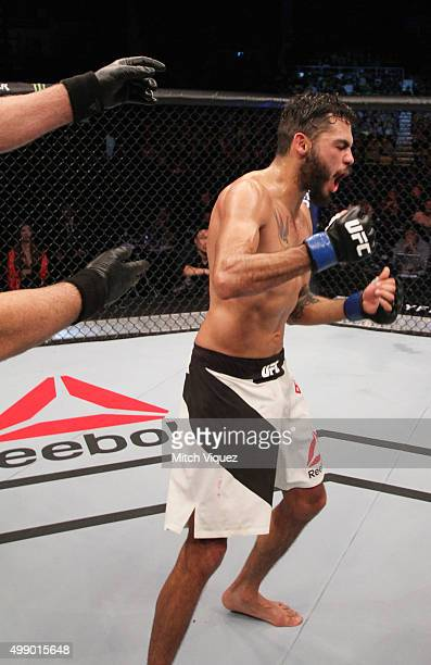 Marco Beltran of Mexico celebrates his win over Ning Guangyou of China in their bantamweight bout during the UFC Fight Night at the Olympic Park...