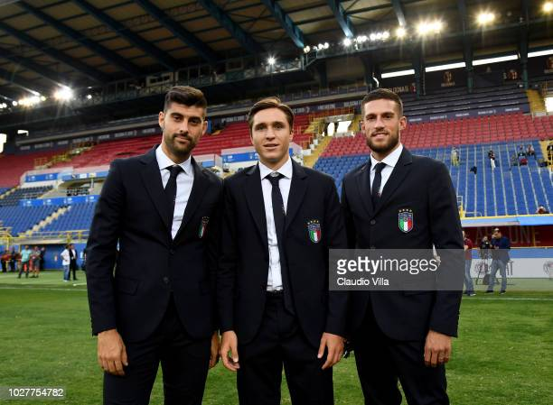 Marco Benassi, Federico Chiesa and Cristiano Biraghi of Italy pose for a photo during Italy walk around at Stadio Renato Dall'Ara on September 6,...