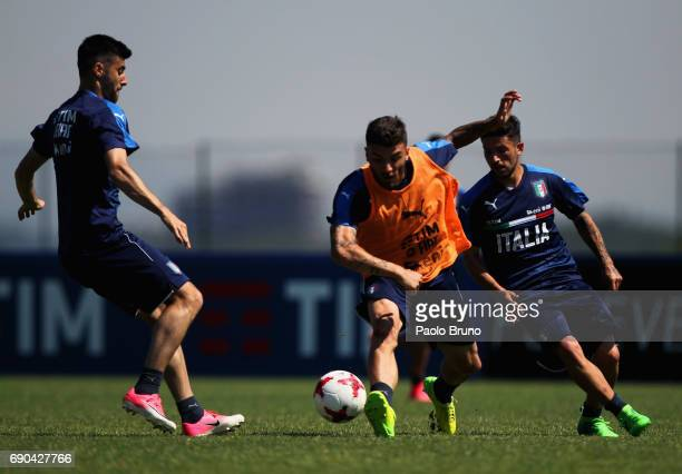Marco Benassi Gaetano Monachello and Stefano Sensi of Italy U21 in action during the Italy U21 training session at Mancini sport center on May 31...