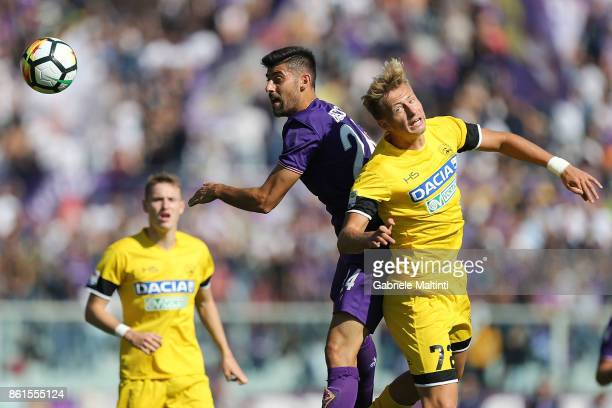 Marco Benassi of ACF Fiorentina battles for the ball with Antonin Barak of Udinese Calcio during the Serie A match between ACF Fiorentina and Udinese...
