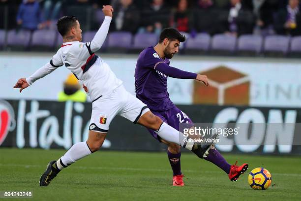 Marco Benassi of ACF Fiorentina battles for the ball with Armando Izzo of Genoa CFC during the Serie A match betweenACF Fiorentina and Genoa CFC at...