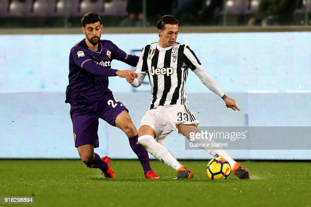 Marco Benassi of ACF Fiorentina battles for the ball with Federico Bernardeschi of Juventus during the serie A match between ACF Fiorentina and...