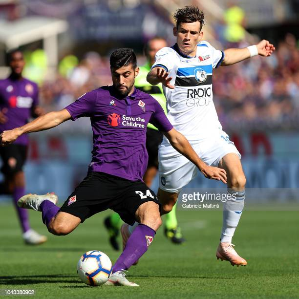 Marco Benassi of ACF Fiorentina battles for the ball with Rafael Toloi of Atalanta BC during the Serie A match between ACF Fiorentina and Atalanta BC...