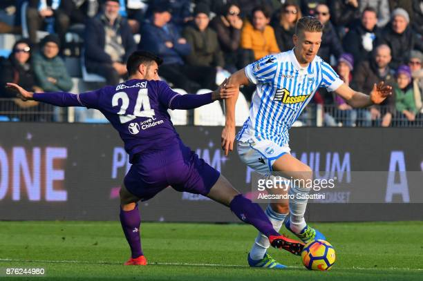 Marco Benassi of ACF Fiorentina competes for the ball whit Bartosz Salamon of Spal during the Serie A match between Spal and ACF Fiorentina at Stadio...