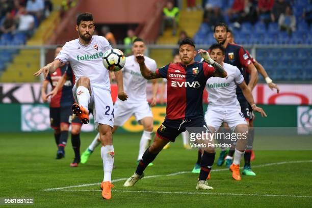 Marco Benassi of ACF Fiorentina in action against Gianluca Lapadula of Genoa CFC during the serie A match between Genoa CFC and ACF Fiorentina at...