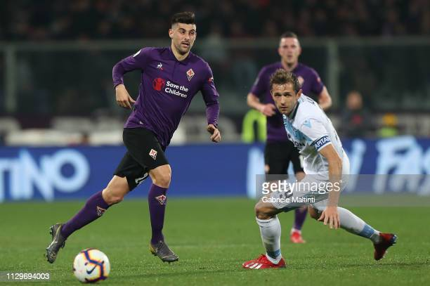 Marco Benassi of ACF Fiorentina in action against Senad Lulic pf SS Lazio during the Serie A match between ACF Fiorentina and SS Lazio at Stadio...