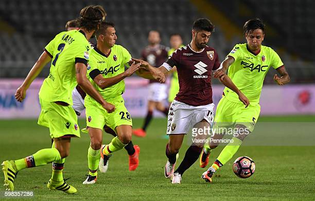 Marco Benassi of FC Torino is challenged by ErickÊPulgar and DanieleÊGastaldello of Bologna FC during the Serie A match between FC Torino and Bologna...