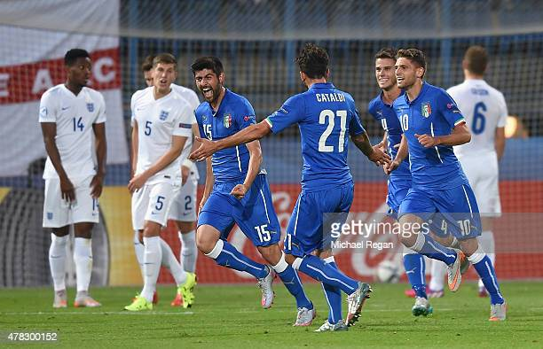Marco Benassi of Italy celebrates with team mates after scoring to make it 2-0 during the UEFA Under21 European Championship match between England...