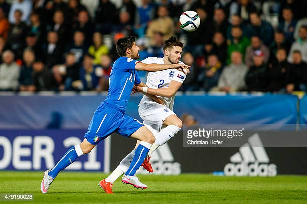 Marco Benassi of Italy competes for the ball with Carl Jenkinson of England during the UEFA Under21 European Championship 2015 match between England...