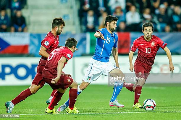 Marco Benassi of Italy competes for the ball with Frederico Venancio Raphael Guerreiro and Bernardo Silva of Portugal during the UEFA Under21...