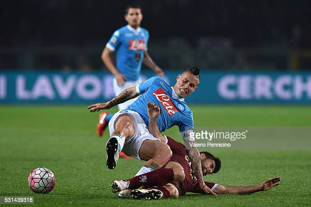 Marco Benassi of Torino FC tackles Marek Hamsik of SSC Napoli during the Serie A match between Torino FC and SSC Napoli at Stadio Olimpico di Torino...