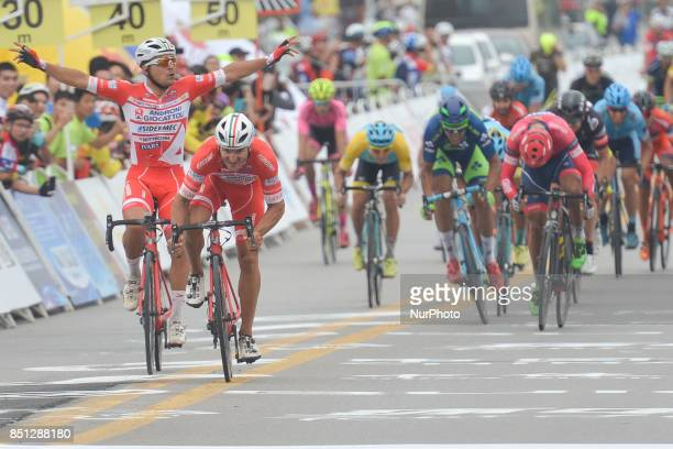 Marco Benfatto assisted by Matteo Malucelli from Androni Sidermec Bottecchia team on his way to win the fourth stage of the 2017 Tour of China 2, the...