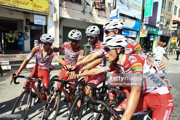 Marco Benfatto of Androni Giocattoli-Sidermec celebrates victory with his teammate after winning Stage 8 of the 24th Le Tour de Langkawi 2019,...