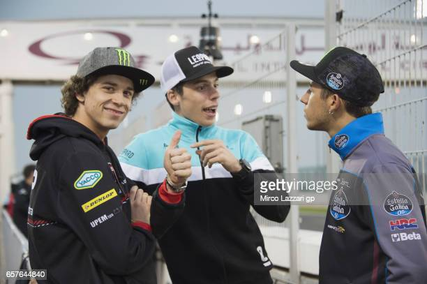Marco Bezzecchi of Italy and CIP Joan Mir of Spain and Leopard Racing and Enea Bastianini of Italy and Estrella Galicia 00 speak in pit during the...