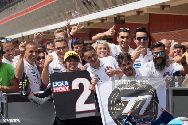 Marco Bezzecchi of Italy and Pruestel GP celebrates the second place with team under the podium at the end of the Moto3 race during the MotoGp of...