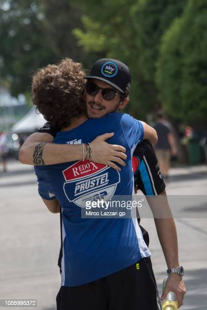 Marco Bezzecchi of Italy and Pruestel GP hugs Francesco Bagnaia of Italy and Sky Racing Team VR46 in paddock during the MotoGP Of Malaysia Previews...