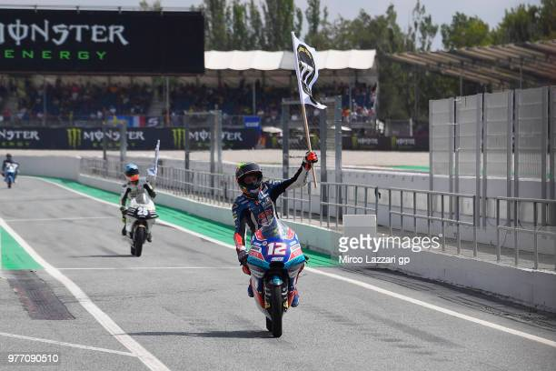 Marco Bezzecchi of Italy and Pruestel GP remembers Andreas Perez of Spain with flag at the end of the Moto3 race during the MotoGp of Catalunya Race...