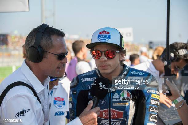 Marco Bezzecchi of Italy and Pruestel GP speaks with journalist and prepares to start on the grid during the Moto3 race during the MotoGP of San...