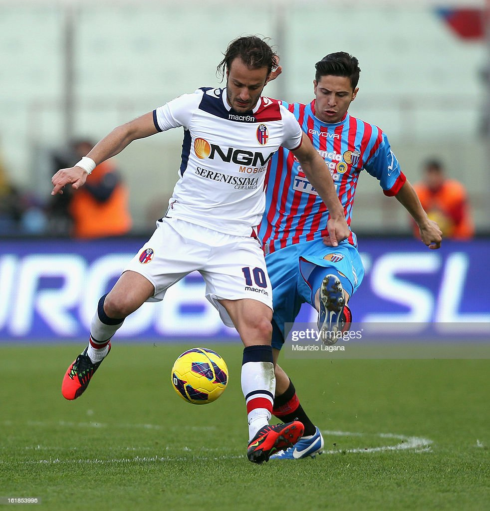 Marco Biagianti (L) of Catania competes for the ball with Alberto Gilardino of Bologna during the Serie A match between Calcio Catania and Bologna FC at Stadio Angelo Massimino on February 17, 2013 in Catania, Italy.