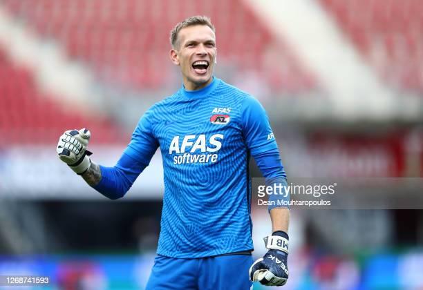Marco Bizot of Alkmaar Zaanstreek celebrates after hos teammate Albert Gudmundsson scored their team's second goal during the UEFA Champions League...