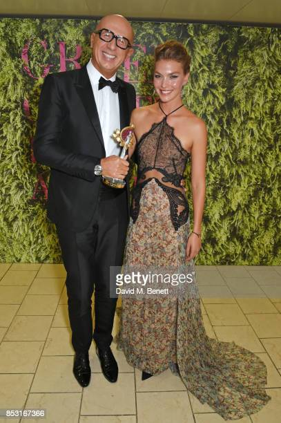 Marco Bizzarri accepting the Supply Chain Innovation award on behalf of Gucci poses with presenter Arizona Muse backstage at The Green Carpet Fashion...