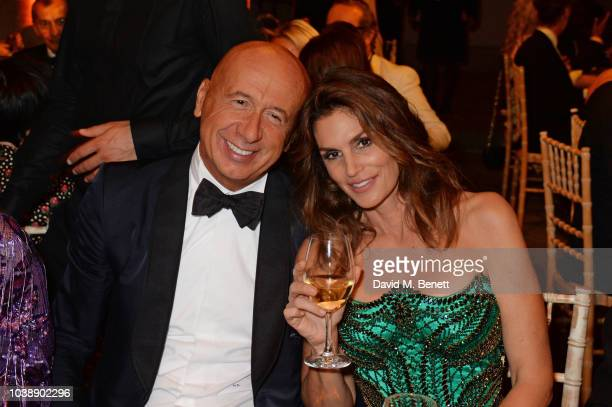 Marco Bizzarri and Cindy Crawford wearing Versace attend The Green Carpet Fashion Awards Italia 2018 after party at Gallerie d'Italia on September 23...