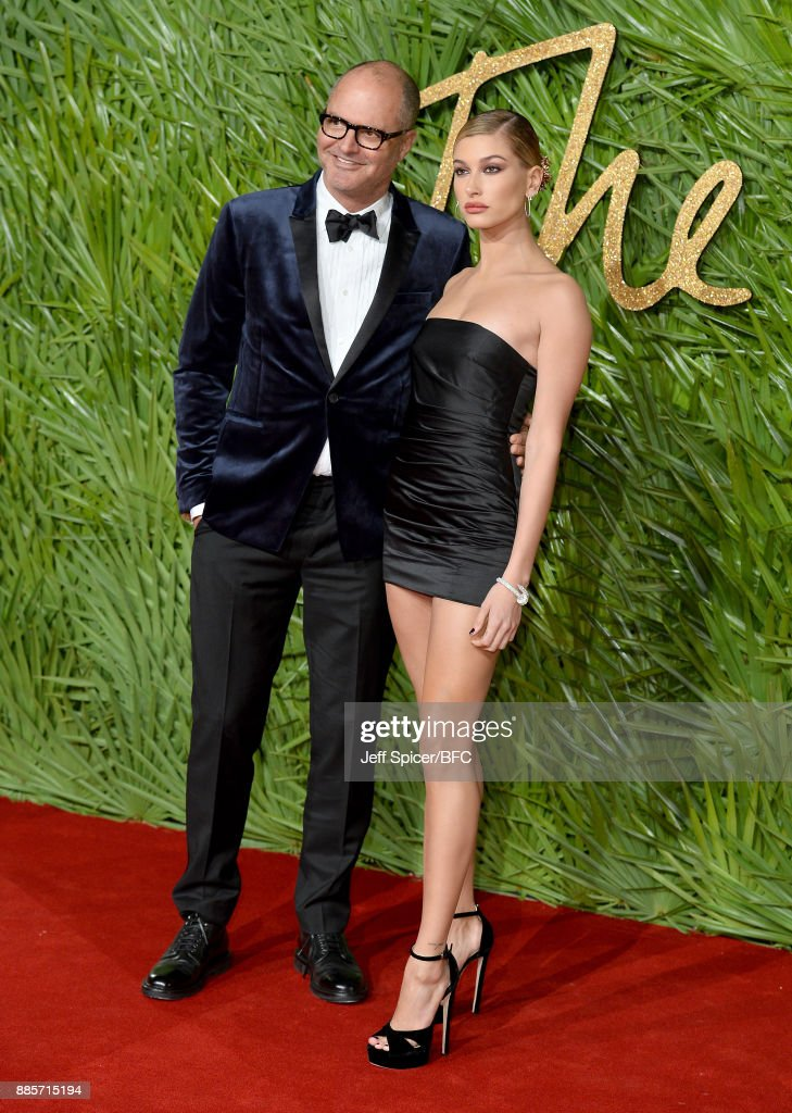 Marco Bizzarri and Hailey Baldwin attend The Fashion Awards 2017 in partnership with Swarovski at Royal Albert Hall on December 4, 2017 in London, England.
