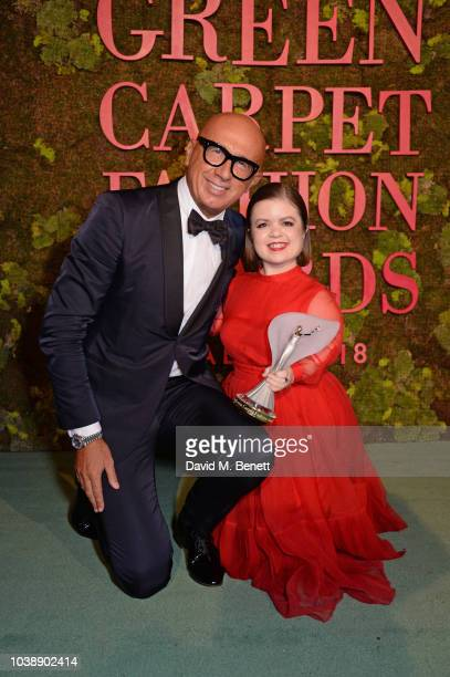 Marco Bizzarri and Sinead Burke winner of The Leaders Award pose backstage at The Green Carpet Fashion Awards Italia 2018 at Teatro Alla Scala on...