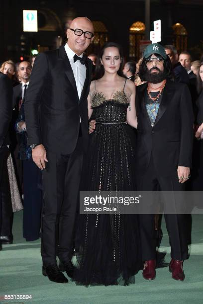 Marco Bizzarri Dakota Johnson and Alessandro Michele attend the Green Carpet Fashion Awards Italia 2017 during Milan Fashion Week Spring/Summer 2018...