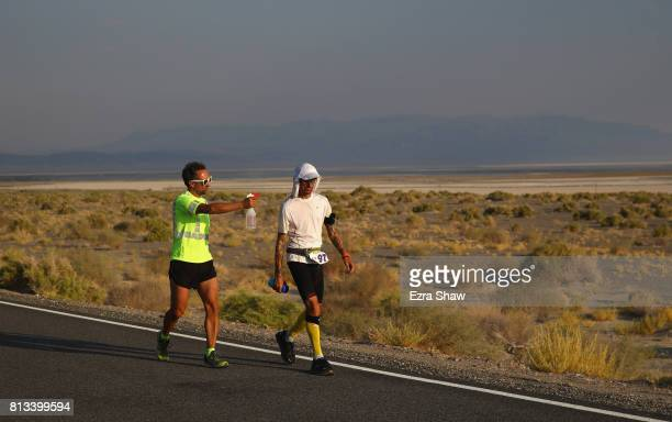Marco Bonfiglio of Italy is sprayed by a member of his support team during the STYR Labs Badwater 135 on July 11 2017 in Death Valley California...