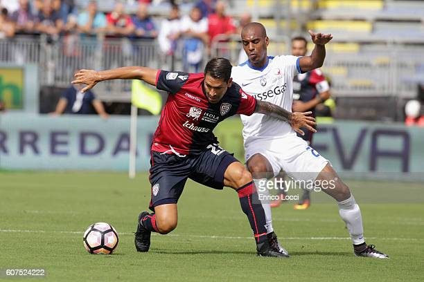Marco Boriello of Cagliari competes for the ball with Abdoulay Konko of Atalanta during the Serie A match between Cagliari Calcio and Atalanta BC at...